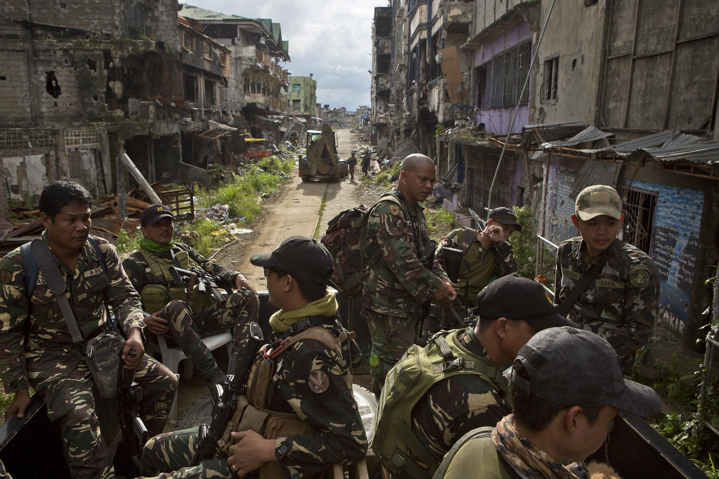 Members of a military joint task force working to clear the main battle area of Marawi of explosives ride in convoy out of the main battle area and back to base.