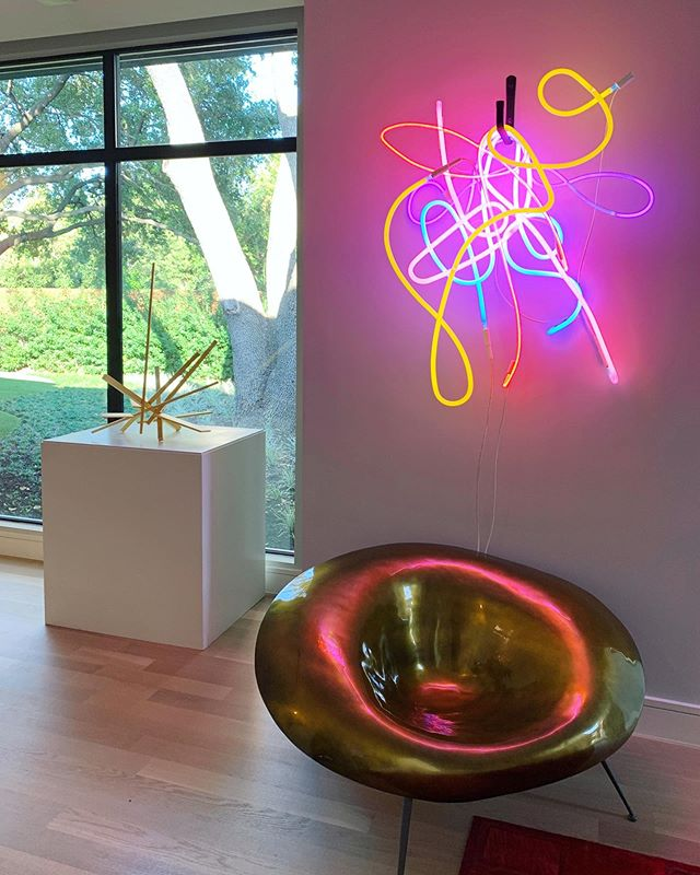 """This is what contemporary sculpture collection dreams are made of... 💫🍭💡 We just installed John Henry's """"Medusa"""" & Lisa Schulte's """"Dreams of My Father 1"""" in our clients' home in Preston Hollow here in Dallas, TX! @johnhenrysculpture @theneonqueen @nightsofneon • • When building a sculpture collection, it's important to draw value from the artwork in many capacities: the artist, history, materials, extraordinary visual experience, & how it will compliment the space & play off of existing architectural design elements. #happyclients #johnhenry #johnhenrysculptor #lisaschulte #theneonqueen #nightsofneon"""