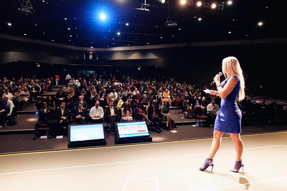 Erna Basson speaking at an event in Johannesburg infront of 1800 audience members