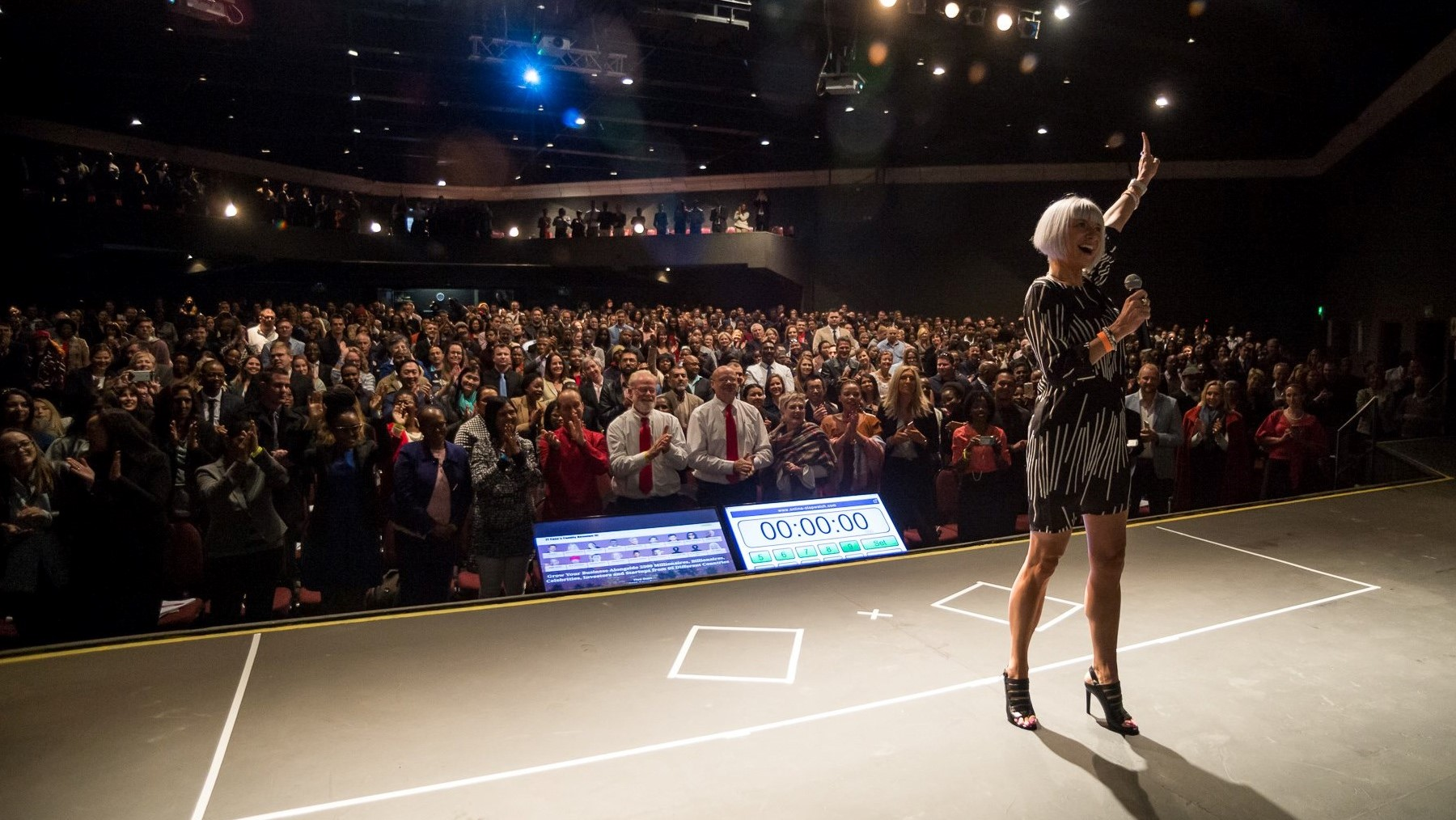 Stéphanie Rottet on stage at JT Foxx's business event in Johannesburg, South Africa in front of an audience of 1800 people. August 2017