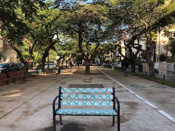 A decorated traditional bench on Rothschild Boulevard in the center of Tel Aviv