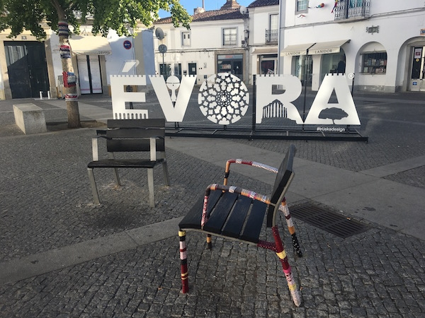 Urban knitting ornates individual seats in the old town of Evora, Portugal