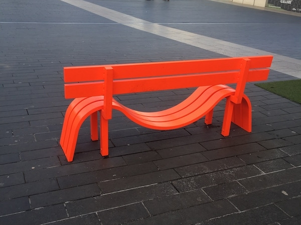 A vibrant super design bench in front of Southbank Centre in London