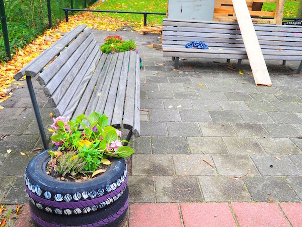 Children asked to bring flowers near the benches and to put them close together
