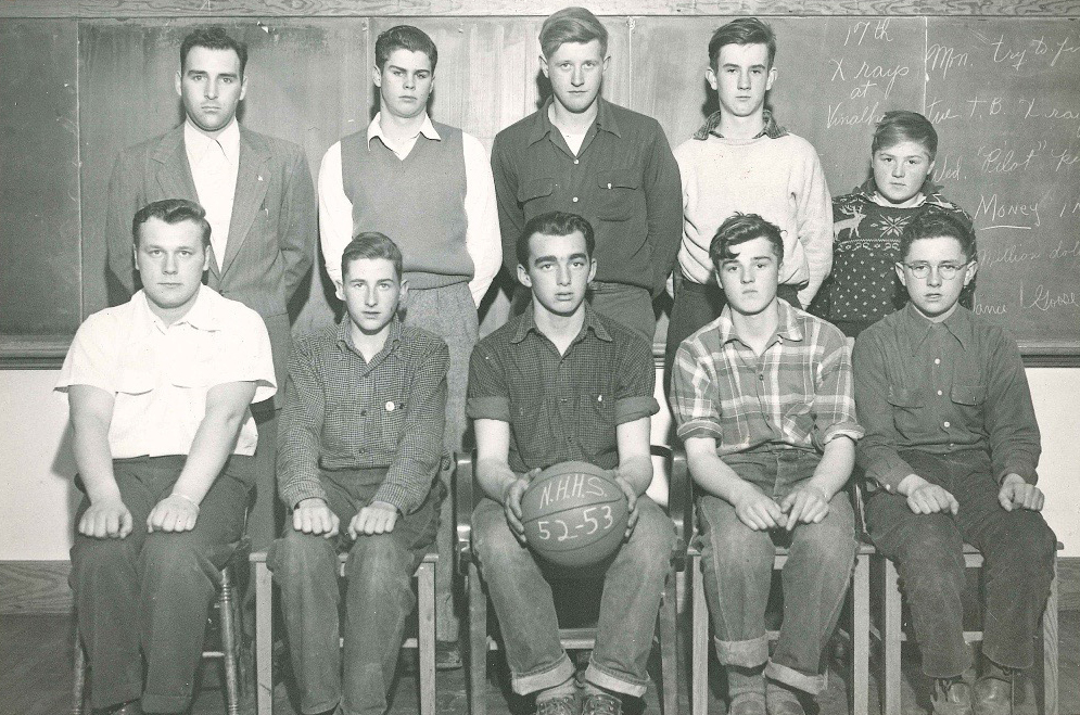 The North Haven boys basketball team, 1952-53. – (Back row left to right) Coach, Jim MacDonald, Fletcher Burgess, Austin Grant, Jerry Brown (Front row left to right)Elliot Brown, Ed Beverage, Bob Staples, Jackie Brown, Doug Stone