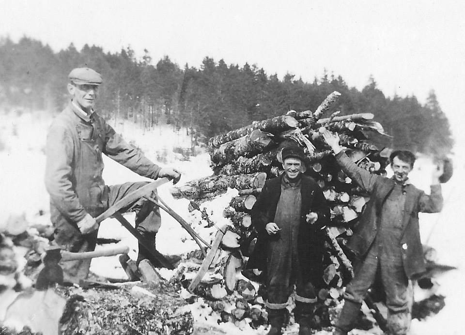 Betty's father (far right) and two other relatives, chopping trees in winter