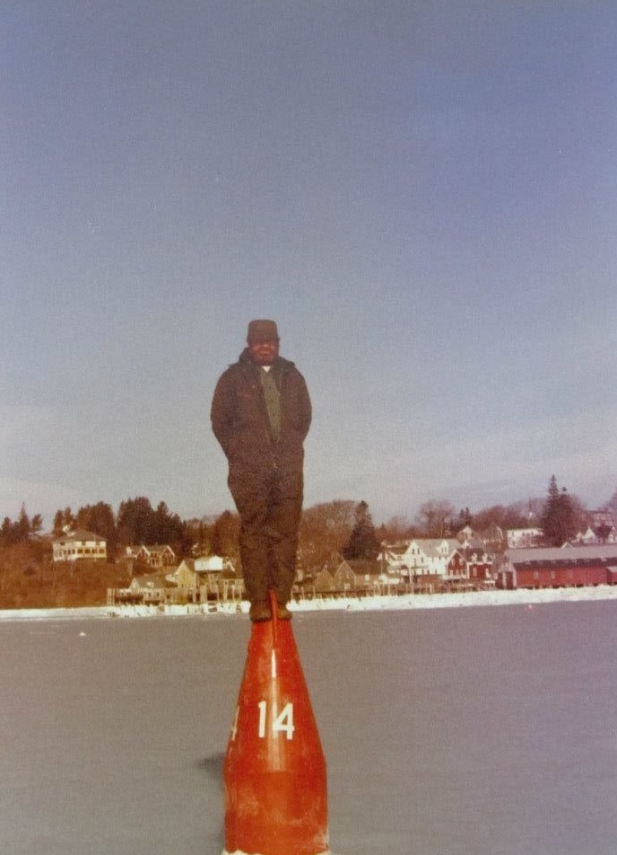 Gene standing on a nun buoy in the frozen Thoroughfare – Photo courtesy of Angela Martin & Jane Brown