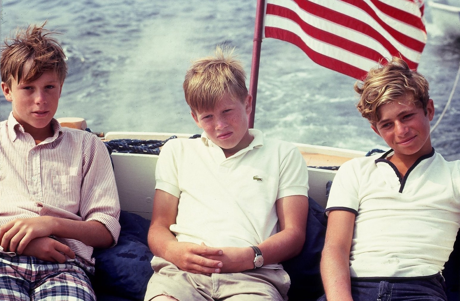 Charlie (right) and two friends out on a boat ride – Courtesy of James Reynolds