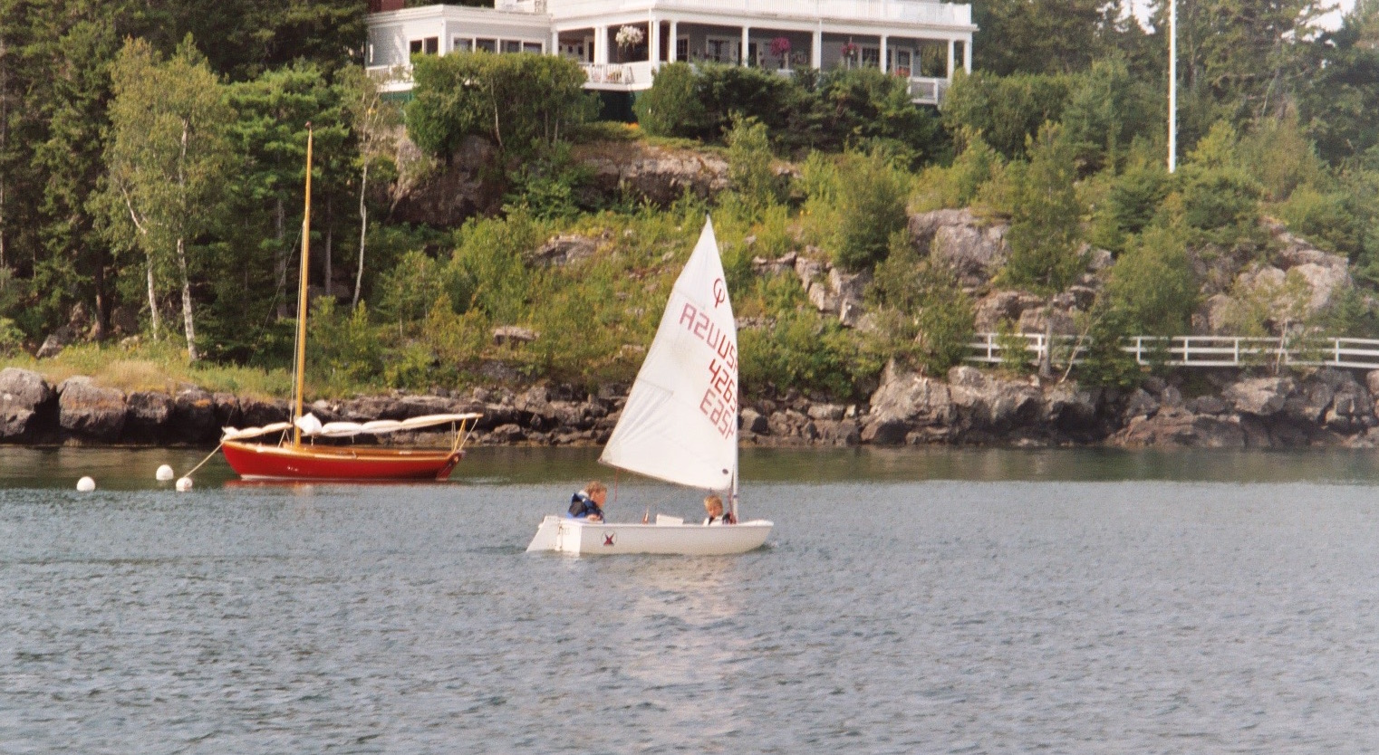 Jakob sailing in the bow of an Optimist