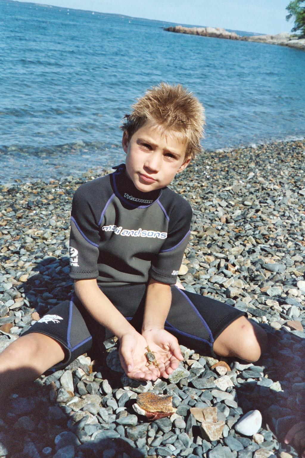 Jakob on a rocky beach