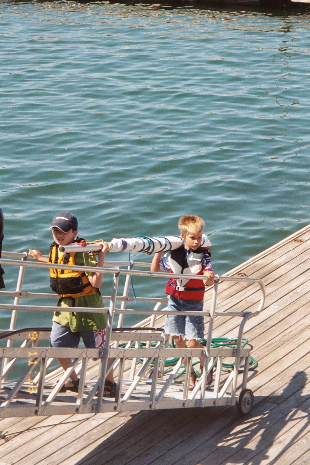 Jakob coming in from sailing class at the island yacht club, the Casino