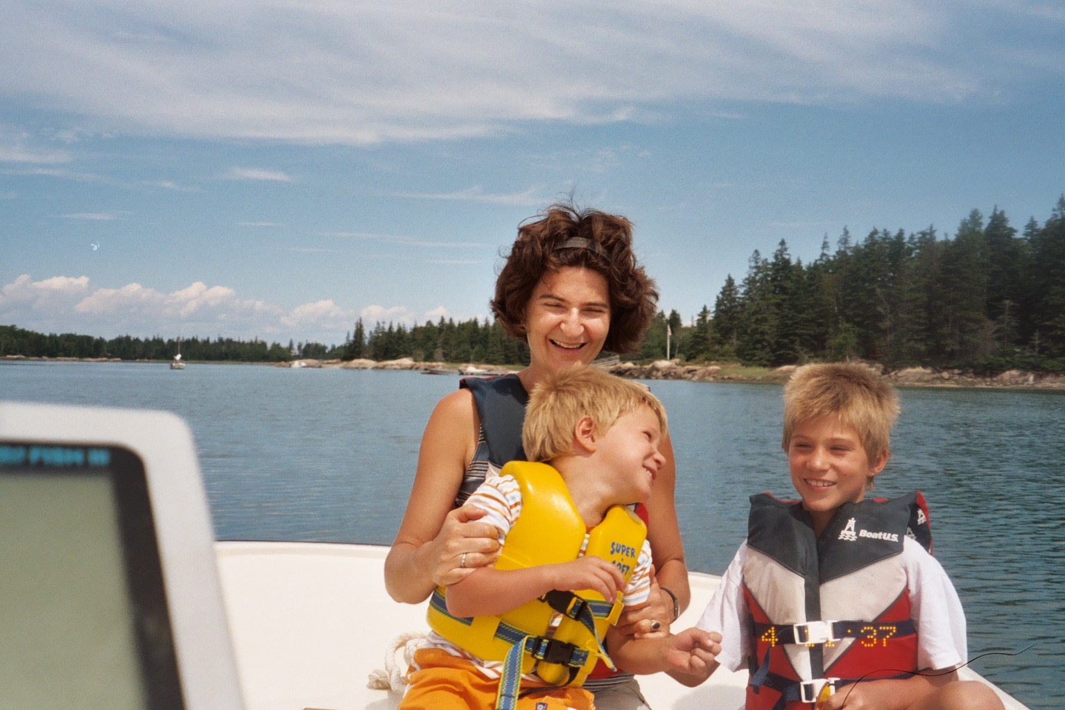 Jakob (right) with his mother and brother out on a boat ride