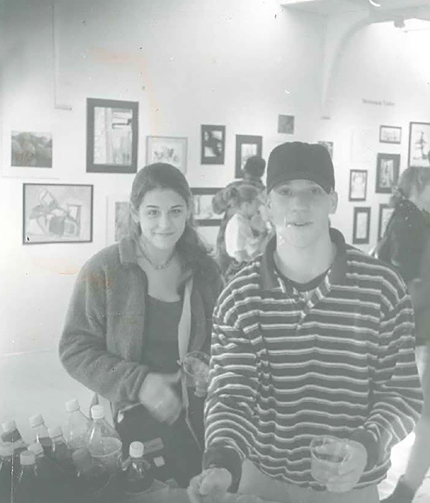 Kim at an art show in high school with an old friend