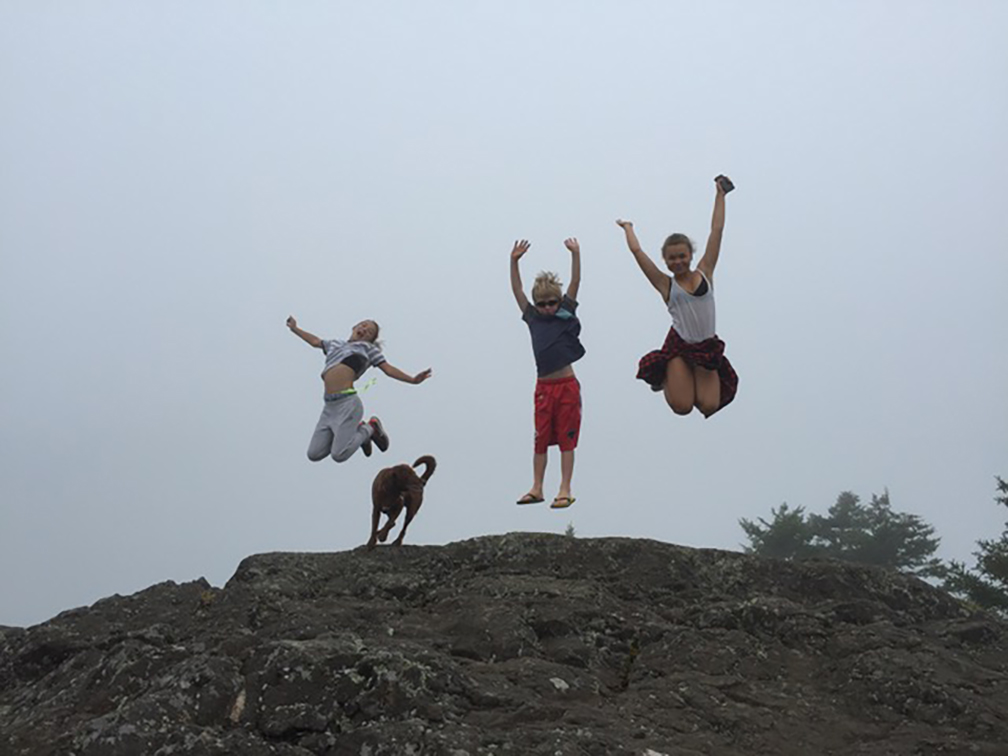 Susan's niece, nephew, and daughter (on right) at the top of The Knob