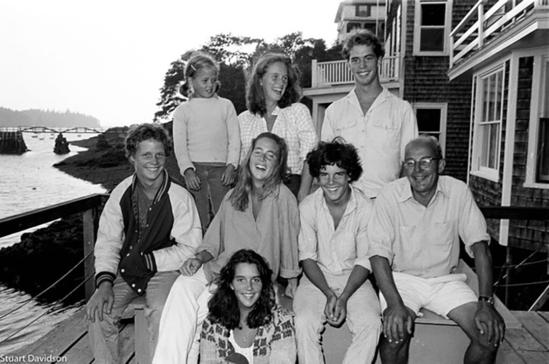 Susan (middle row, on left) with her six siblings and father outside their home on North Haven, 1978