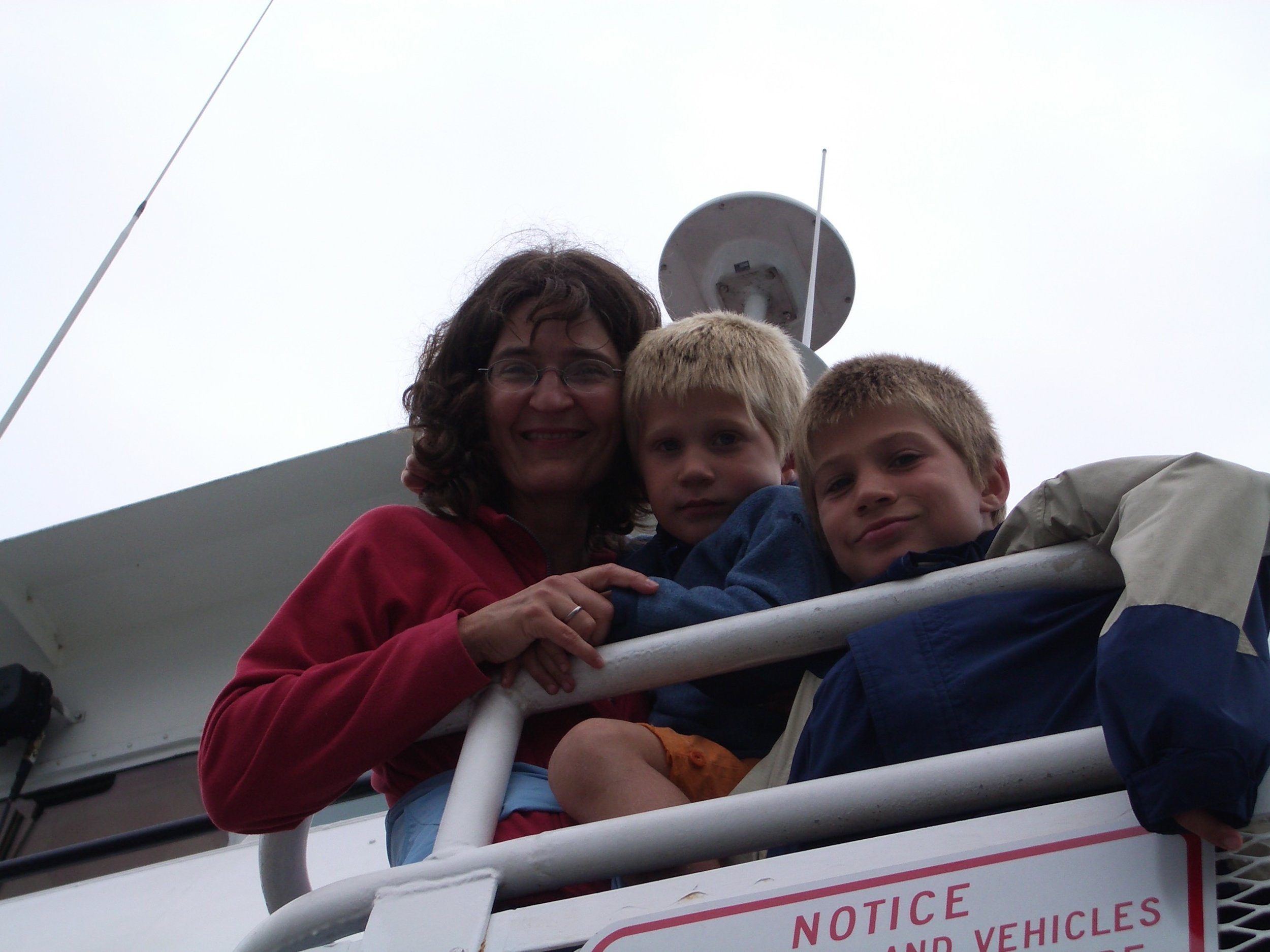Jakob (right) with his mother and brother on the ferry