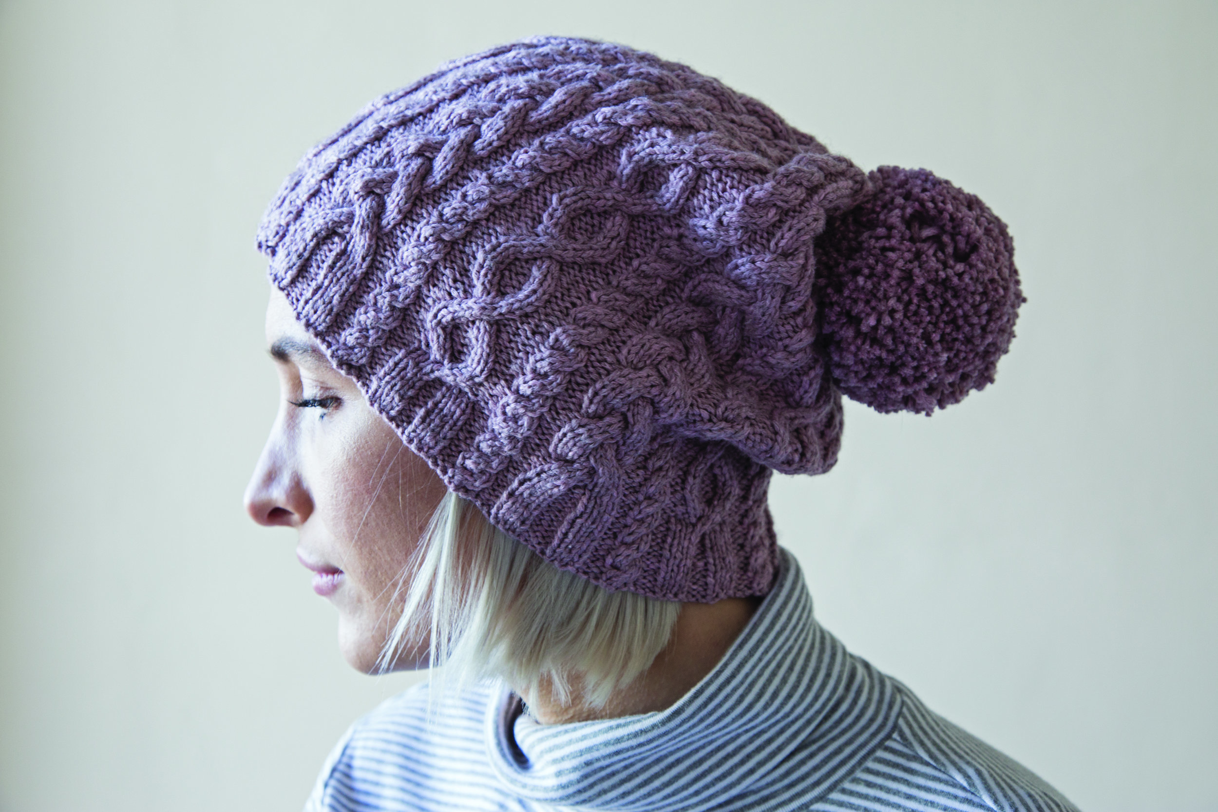 """Harriet modelling the """"hers"""" version of the His and Hers Hats in    Easy Aran Knits   ."""