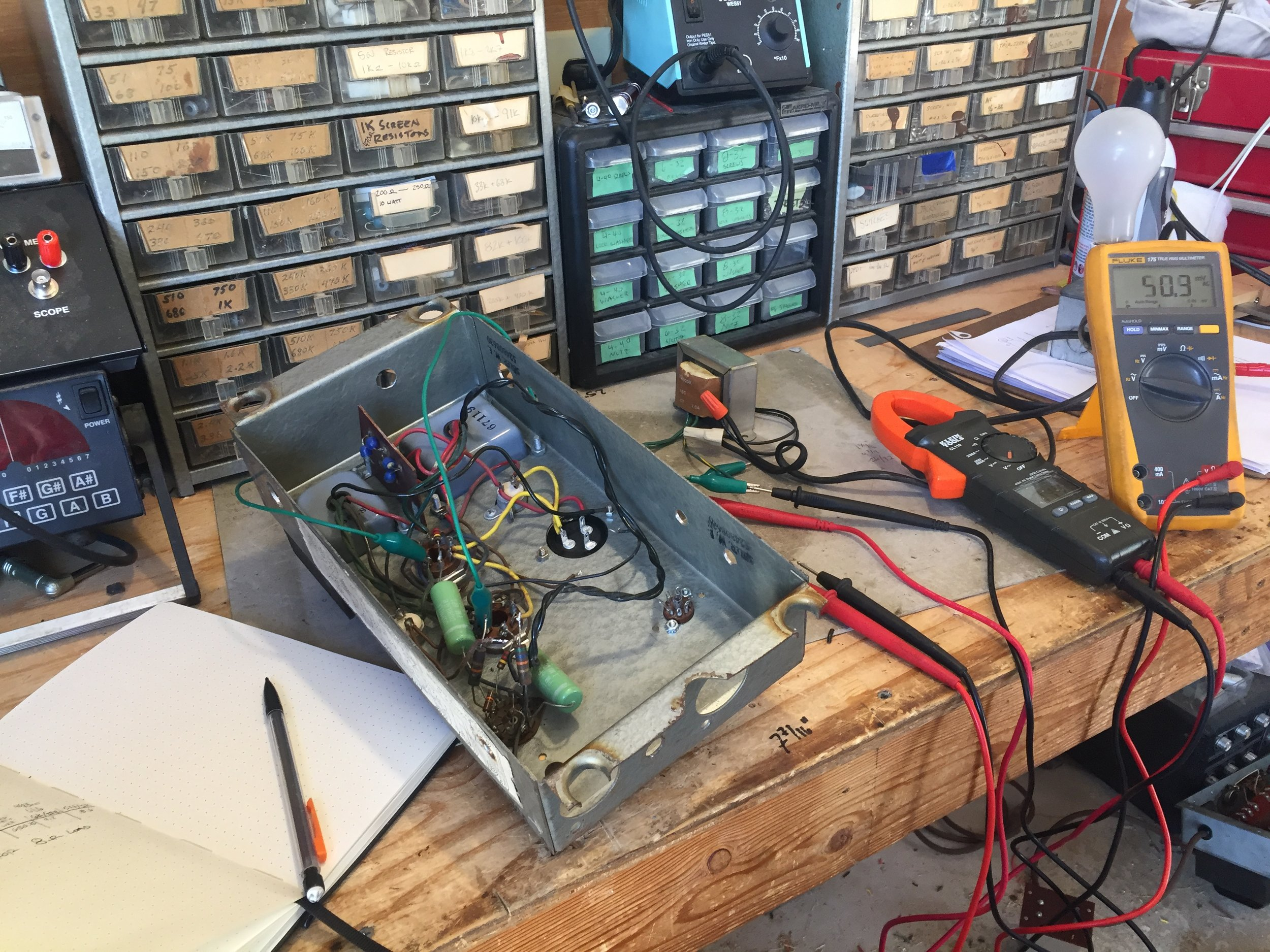 Measuring and computing the impedance ratio of the output transformer.