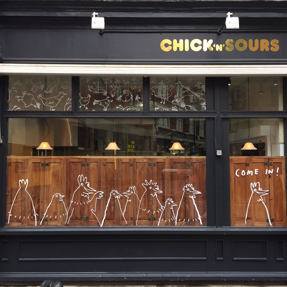 Illustrated chickens on the window of restaurant