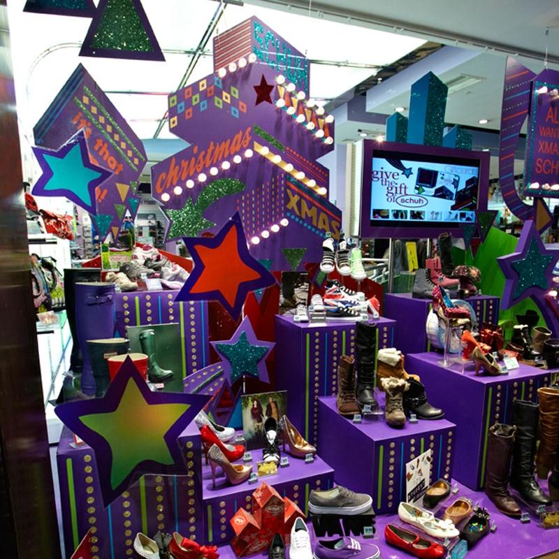 Purple Christmas plinths displaying shoes