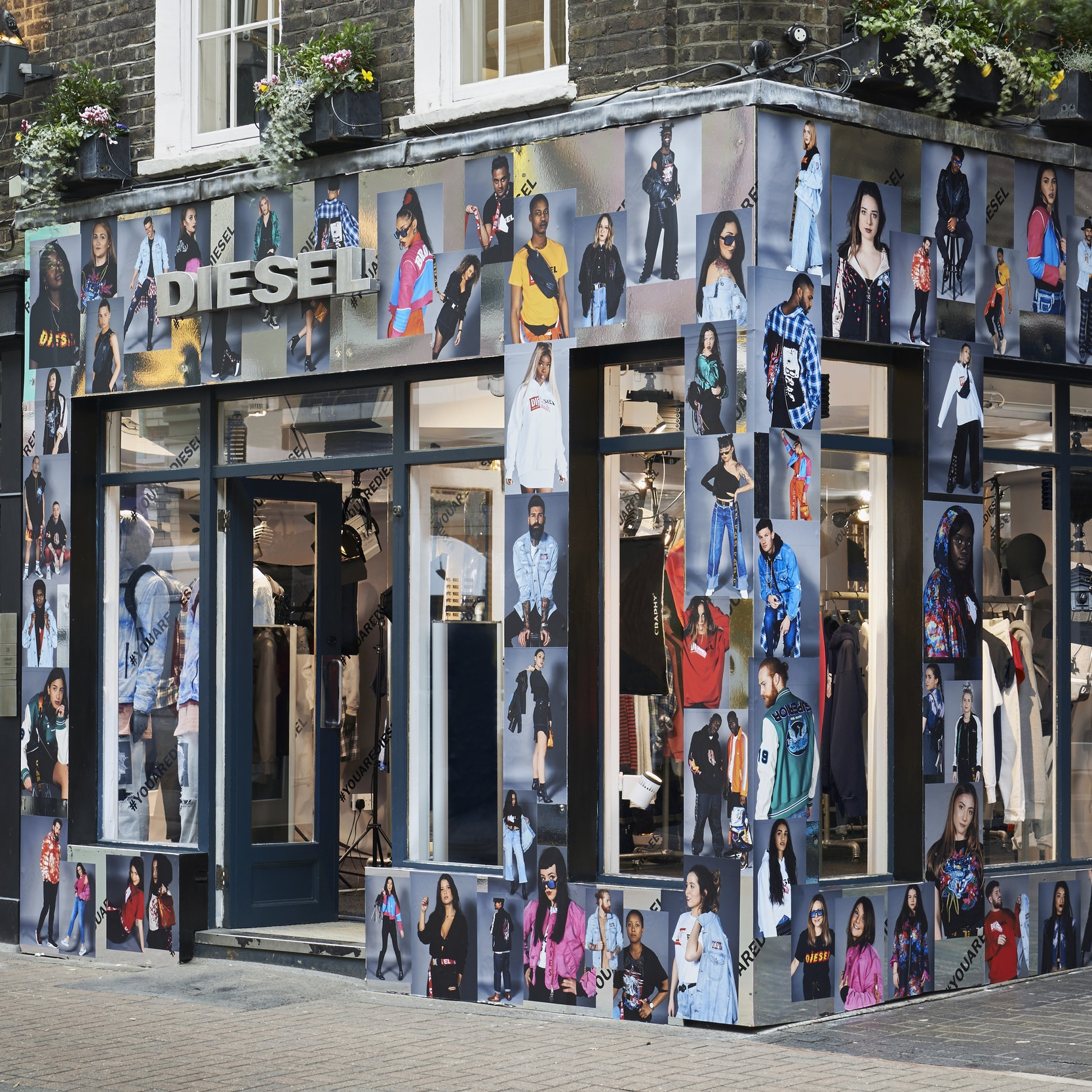 Exterior of Diesel store with fashion images stuck to mirror exterior