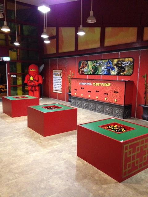 LEGO Ninjago room with LEGO ninja man, LEGO building stations and interactive button display