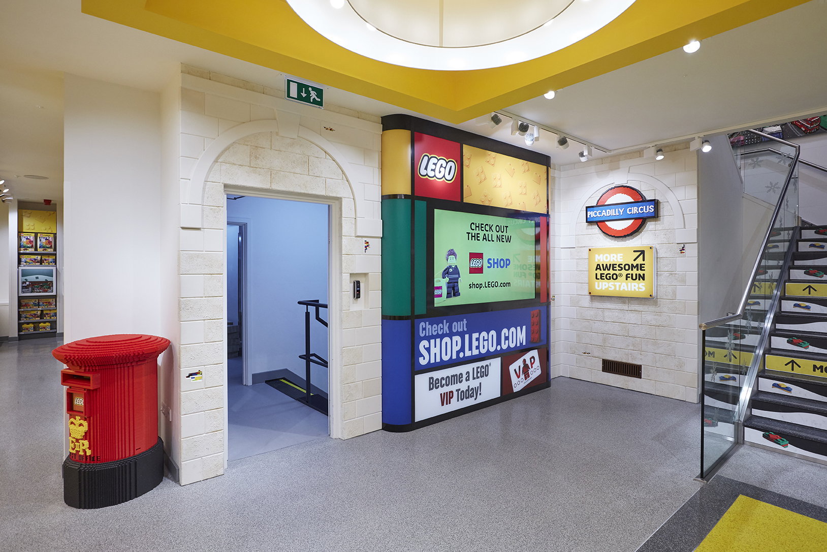 LEGO TV information display corner with false wall cladding and LEGO signage