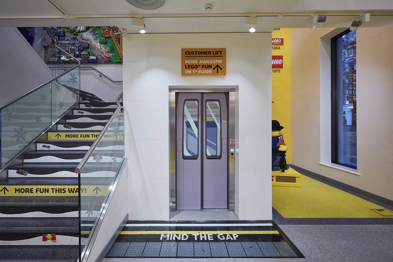Store lift with graphic vinyls over the top and vinyl's on the stairs
