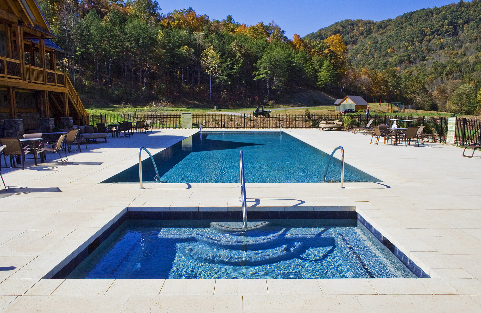 Spa & Pool: The visual enjoyment and interaction from the spa of this perimeter overflow design is clear.