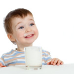 little child drinking soy milk