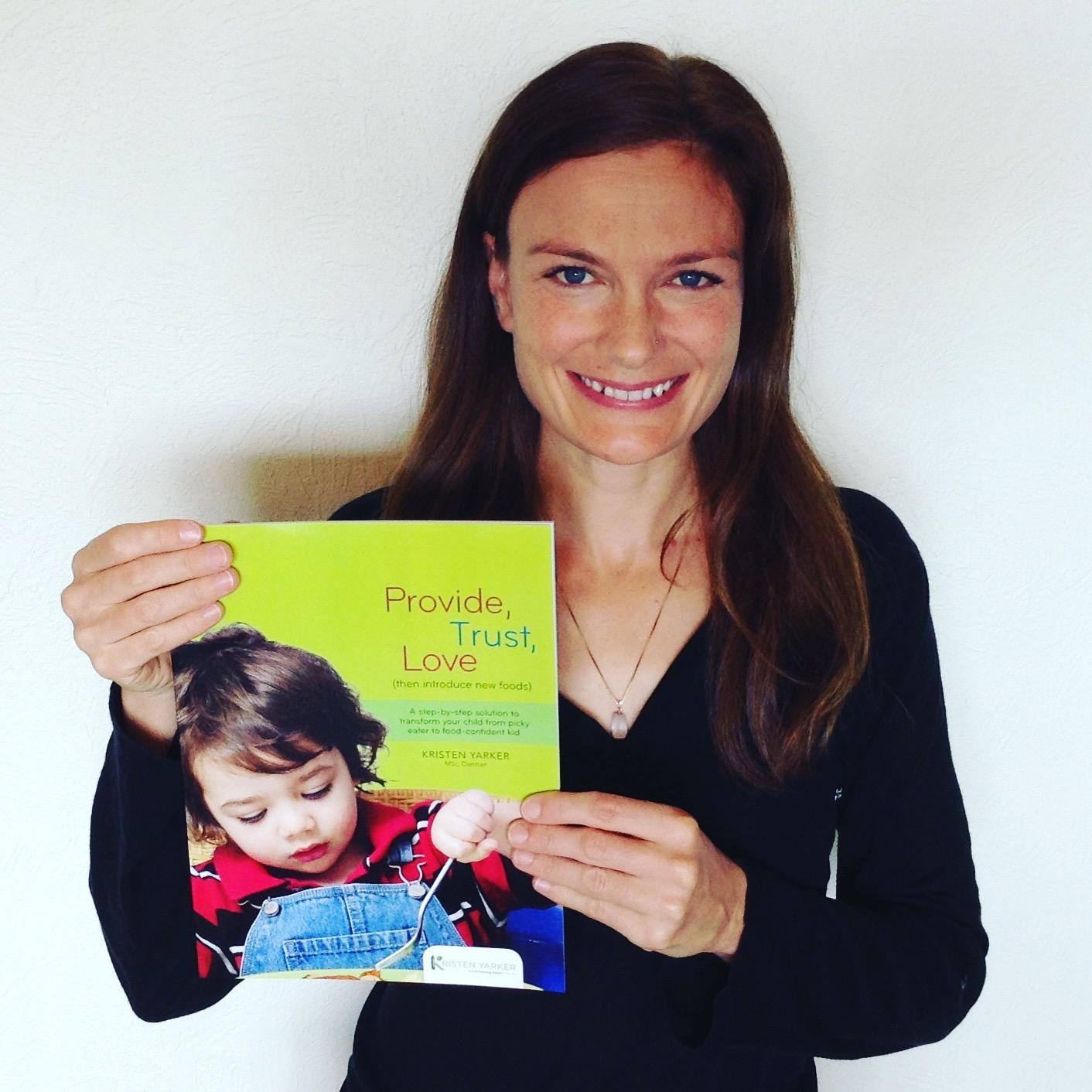Kristen holding book.JPG