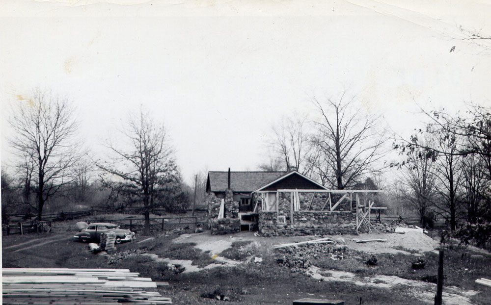 Adding a bedroom to the first cottage, now covered in stones, about 1950.