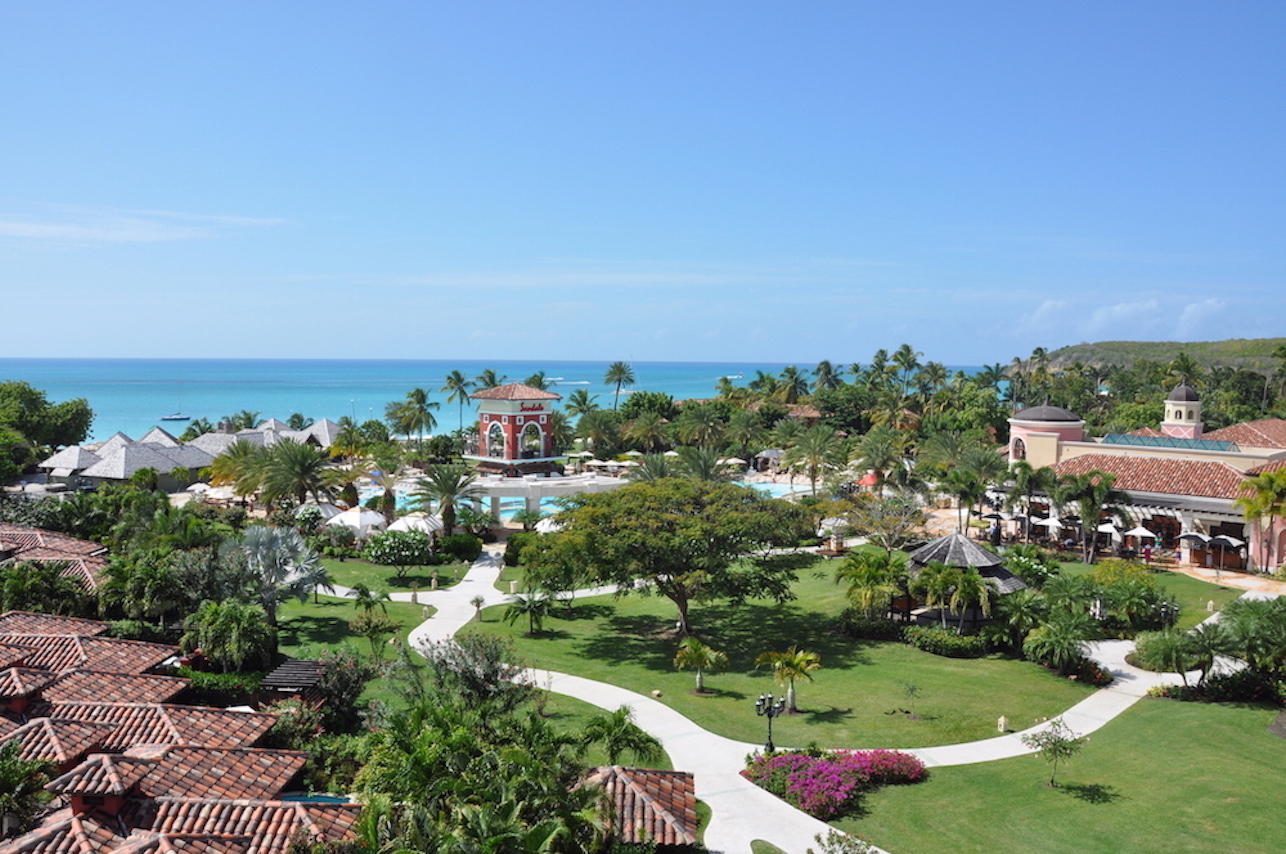 Sandals Antigua - Travvy Award Winner - Caribbean's Most Romantic Resort 2019: Sandals Grande AntiguaVoted the most romantic resort year after year, Sandals Grande Antigua is located 15 minutes from the airport on Dickenson Bay. This Caribbean beach is the best and most famous of Antigua's 365 beaches with beautiful sandy white beaches. The property is lush with foliage and countless winding passages that afford you the illusion of being alone on a deserted island. The accommodations are divine not matter where you stay. The Mediterranean Building sits at the back of the building and provides endless viewing splendor of the varying colors the sea provides. The Caribbean Beachfront Village meanders throughout the property and offers rooms closer to the sand and water.How about the casinos? Well, ask us if the casino right next to the property is open.MORE PICTURES