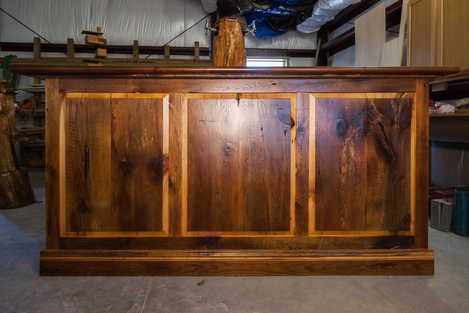 This barn-wood bar is made from 100 percent recycled wood. The tap tower comes from a cypress tree that was toppled by Hurricane Irma in 2017.