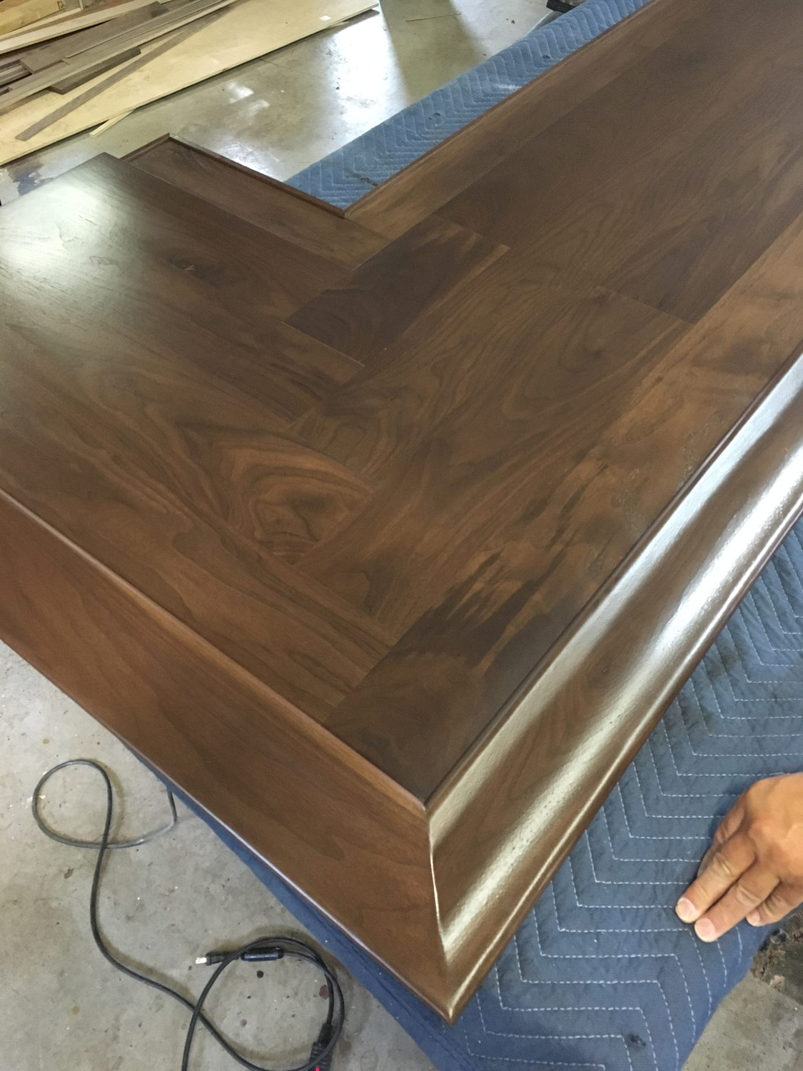 The wood grain and herringbone pattern in this walnut bar-top will become richer in color and depth as the wood ages.