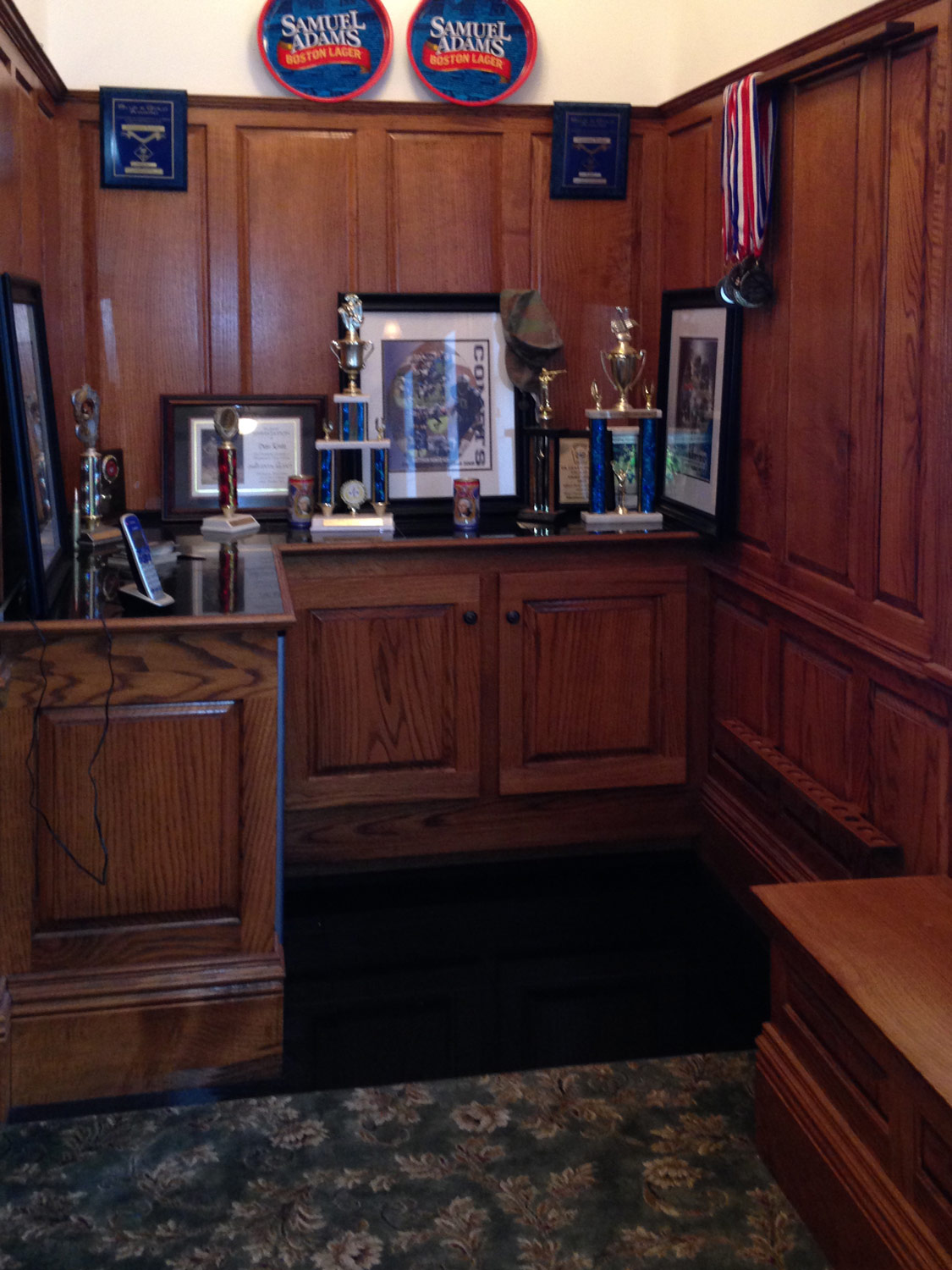 A nice intimate nook for the kids trophies and awards.