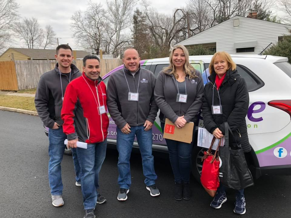Inspire FCU President/CEO Jim Merrill (center) and ARC Eastern PA CEO Guy Triano (middle left) with volunteers during the End Home Fires campaign January 19, 2019.