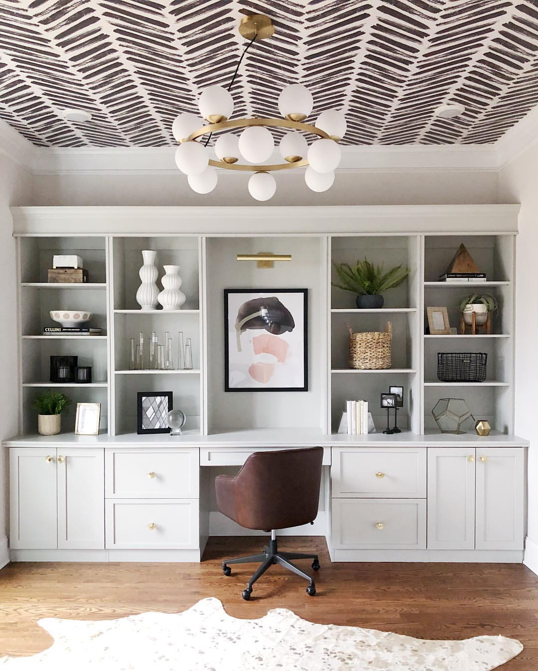 Get creative with wallpaper, like creating a unique wallpapered ceiling. Photo by  @kfddesigns