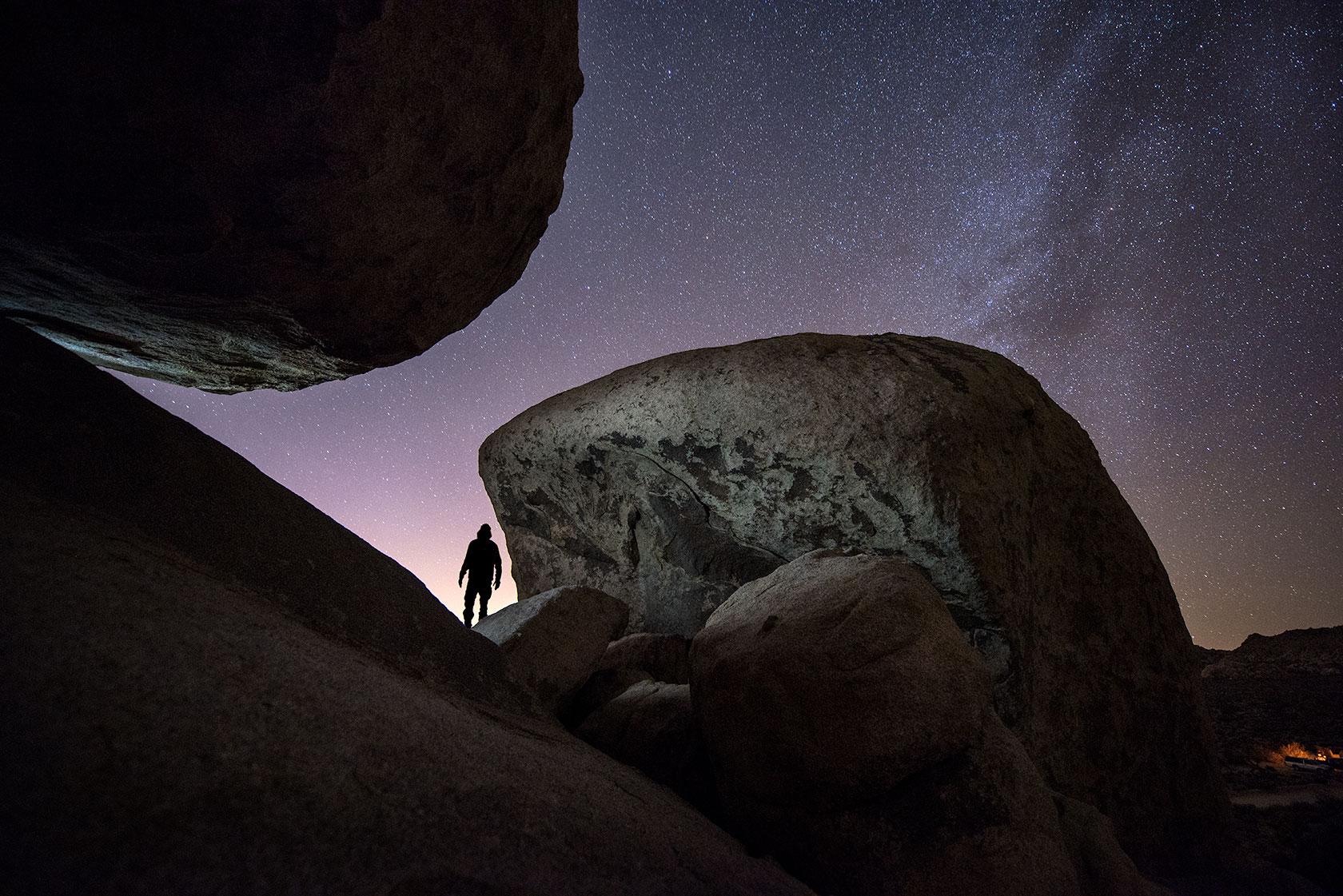 austin-trigg-joshua-tree-national-park-hiker-explores-milky-way-night-sky-stars-rocks.jpg