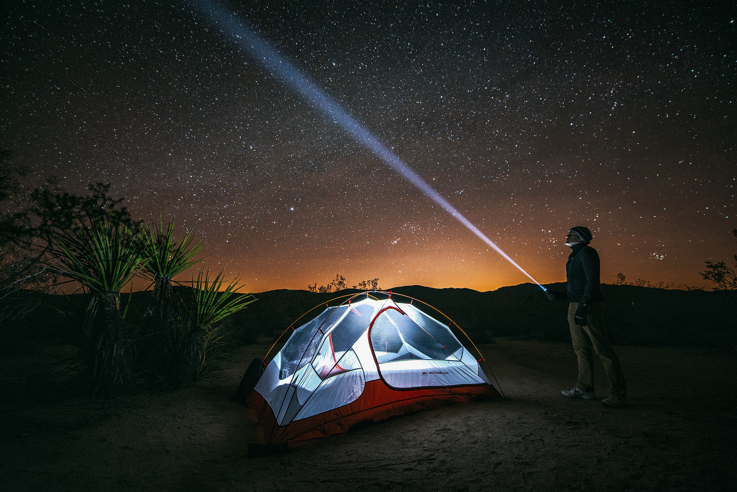 austin-trigg-joshua-tree-national-park-glow-tent-light-long-exposure-night-sky-stars.jpg
