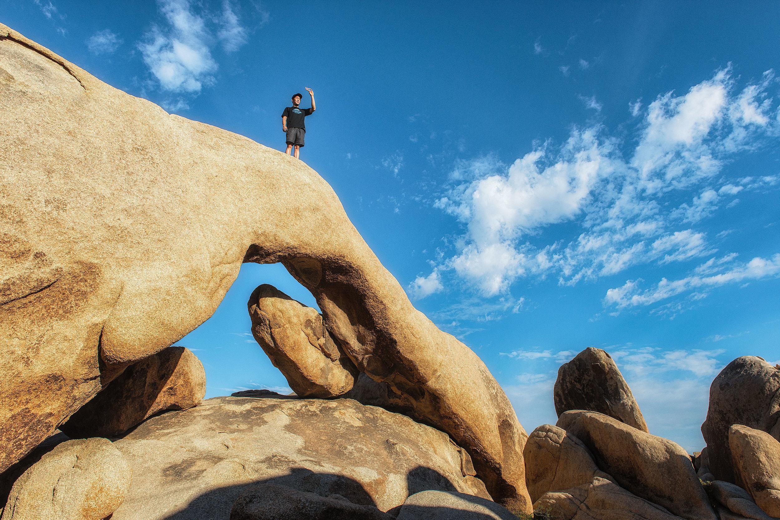 austin-trigg-joshua-tree-national-park-hiker-top-arch-rock-picture.jpg
