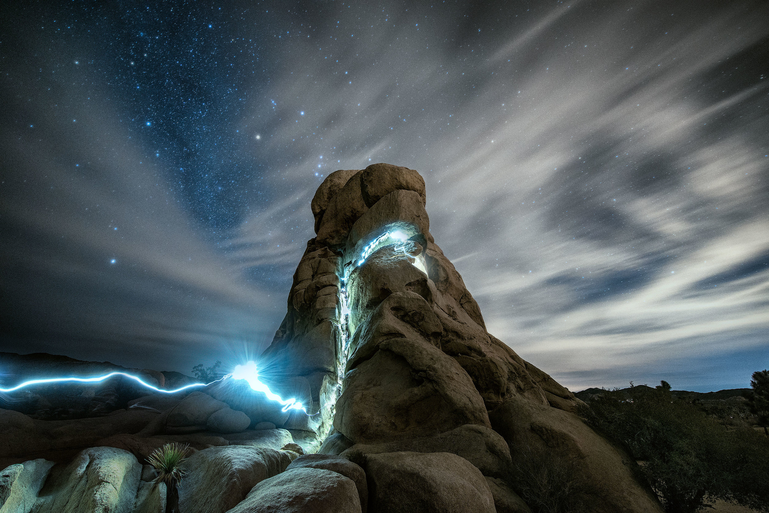austin-trigg-joshua-tree-national-park-long-exposure-rock-climbing-night-sky-stars-clouds-streak.jpg