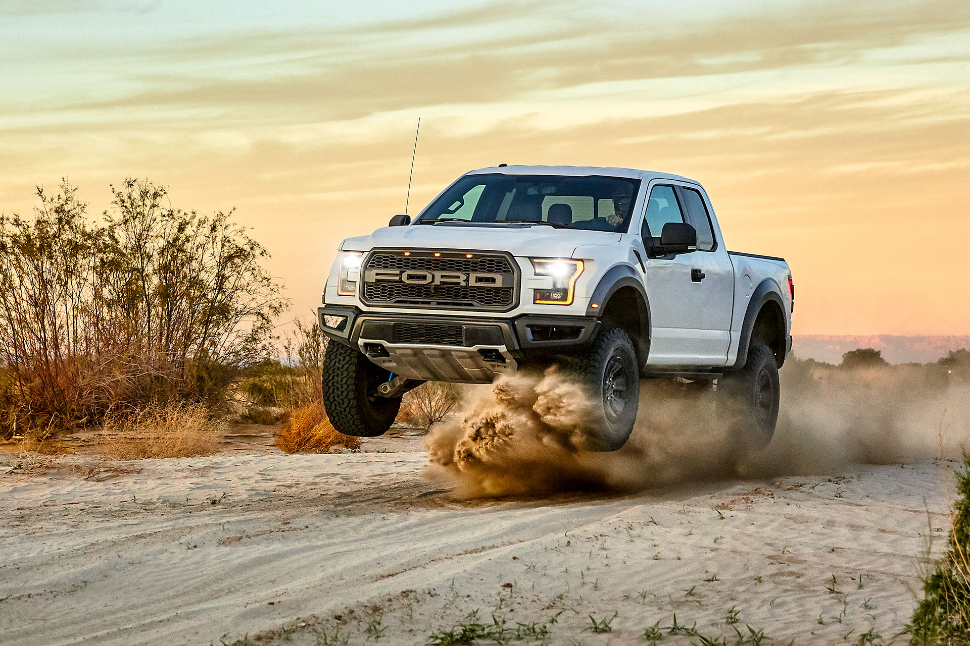 austin-trigg-southern-california-White-raptor-ford-truck-jump-desert-anza-borrego-sunset-dust-driving.jpg