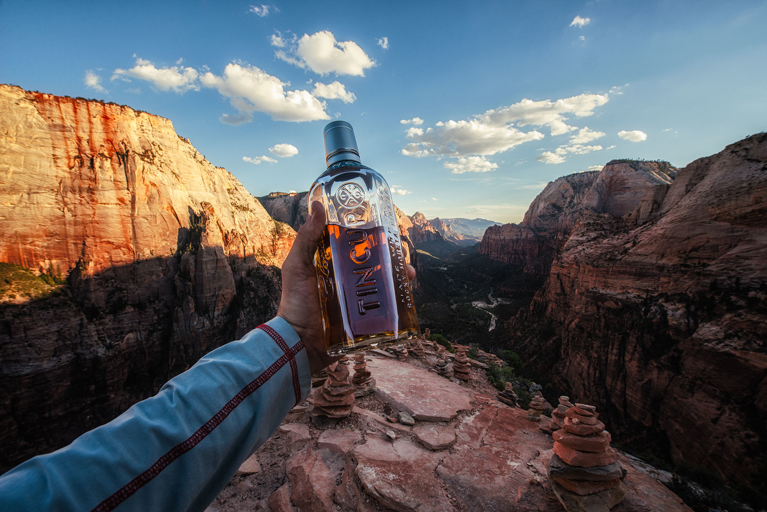austin-trigg-whiskey-lifestyle-zion-product-TINCUP-Hand-Held-pov-angels-landing-valley.jpg