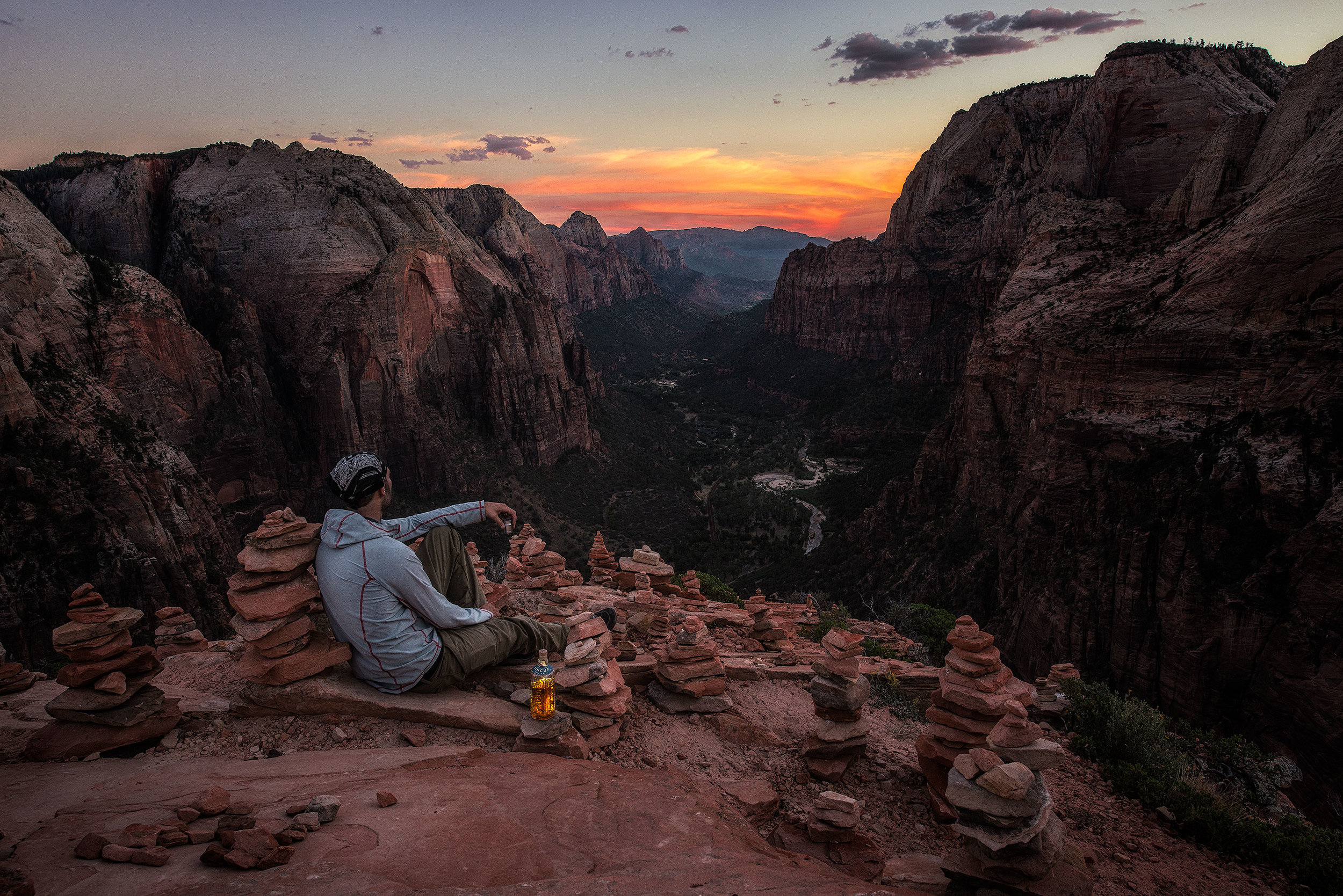 austin-trigg-whiskey-lifestyle-zion-product-TINCUP-Sunset-Cairn-Sitting-valley.jpg