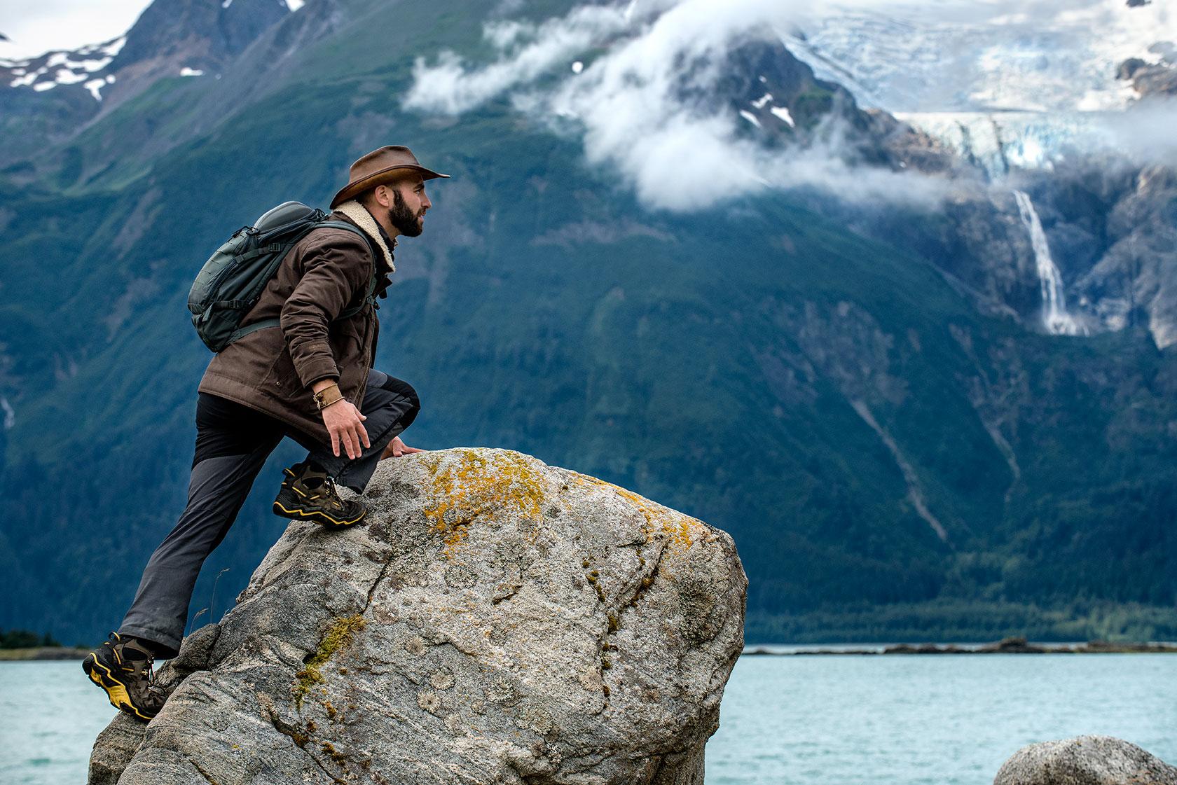austin-trigg-brave-wilderness-alaska-BW-Coyote-Climbs-Rock-Chilkat-Park.jpg