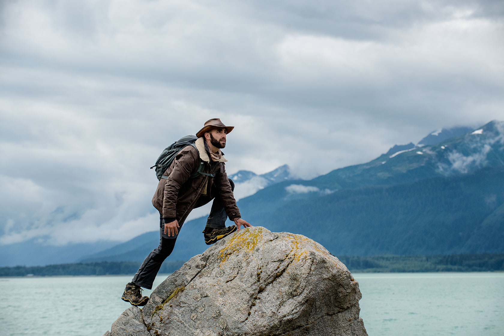 austin-trigg-brave-wilderness-alaska-BW-Coyote-Climbs-Rock.jpg