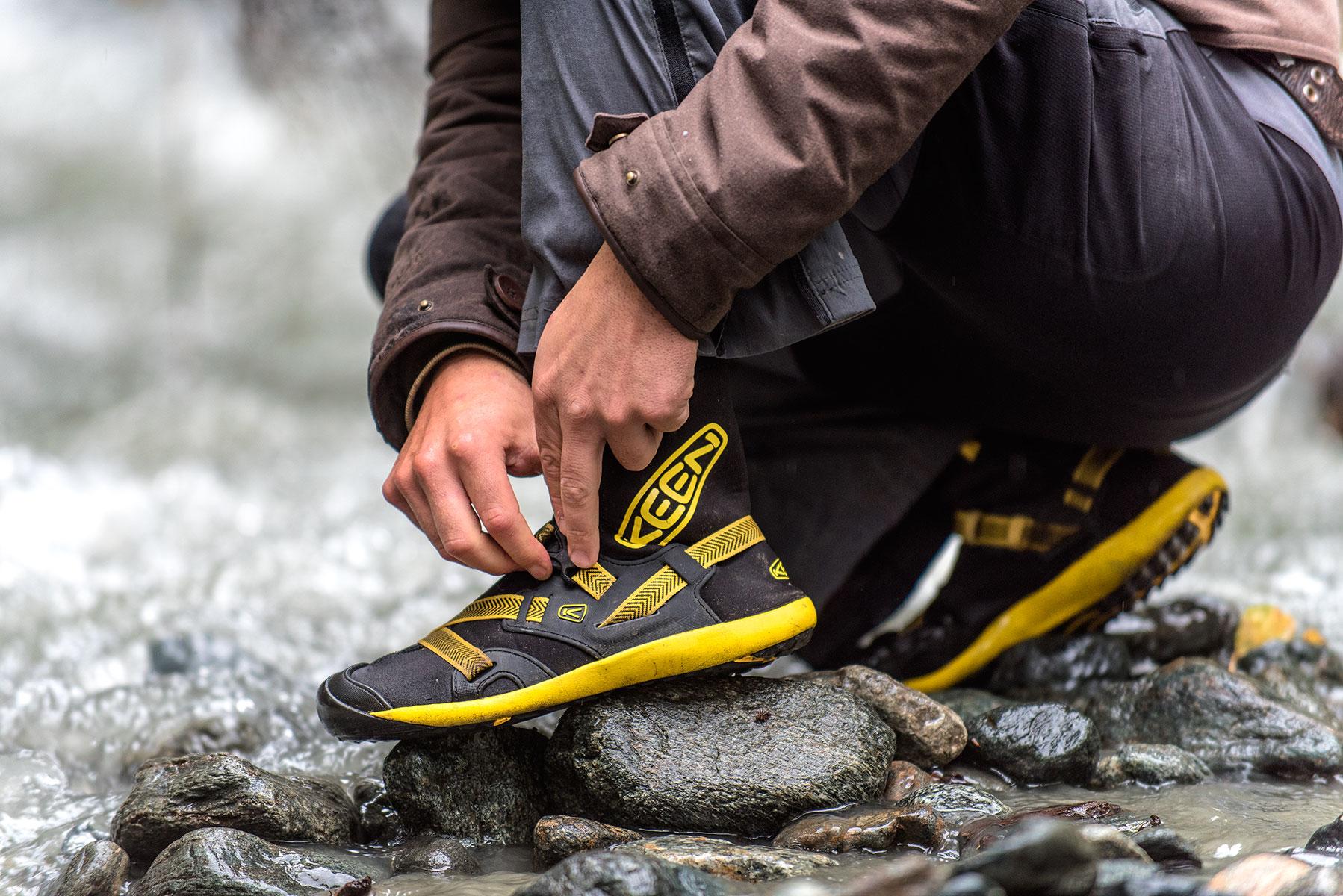 austin-trigg-brave-wilderness-alaska-BW-Coyote-Clips-Keen-water-boots.jpg