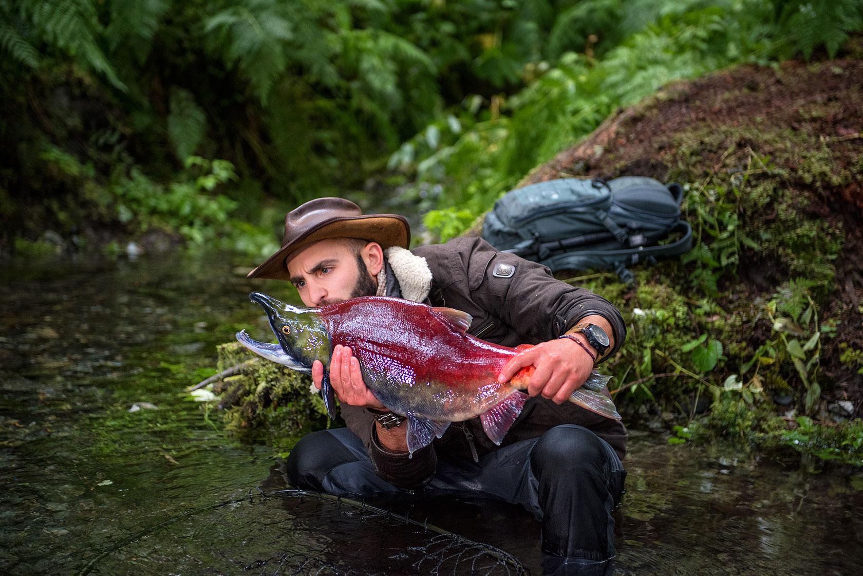 austin-trigg-brave-wilderness-alaska-BW-Coyote-Examines-Salmon.jpg