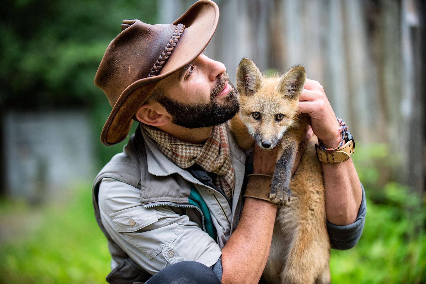 austin-trigg-brave-wilderness-alaska-BW-Coyote-Fox-hold.jpg